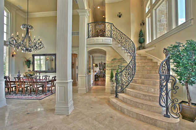 Waterfront mansion in texas homes of the rich for Luxury staircase