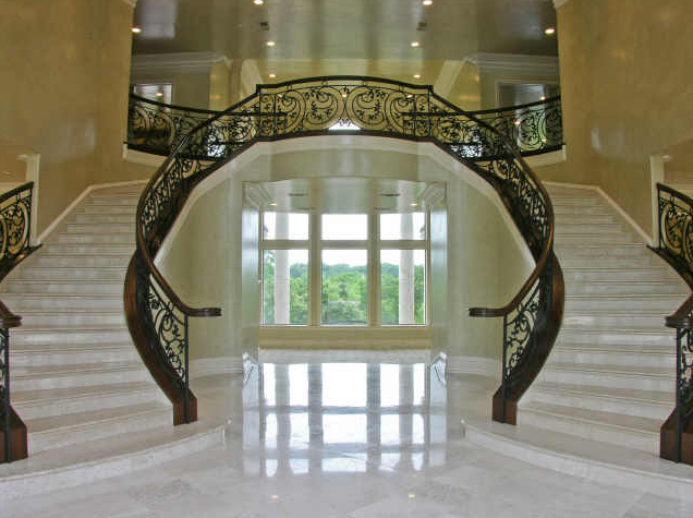 23 000 square foot mediterranean style mansion in texas for Double curved staircase