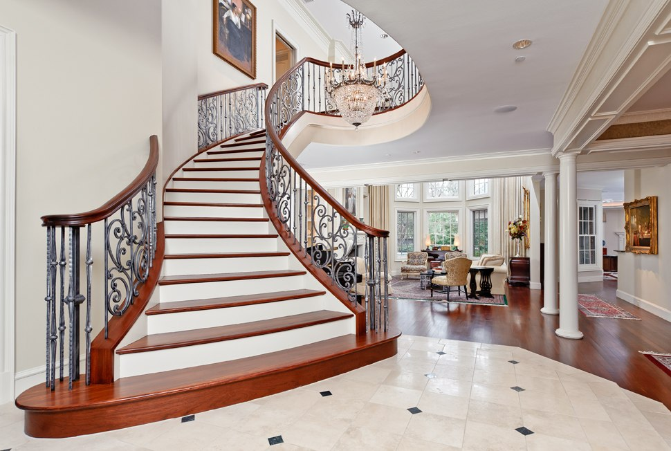 Beautiful curved staircase in texas luxury stairs gallery for Luxury staircases