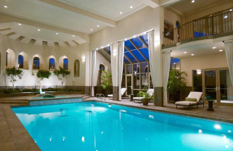 Which indoor swimming pool do you prefer homes of the rich for Luxury ranch house plans with indoor pool