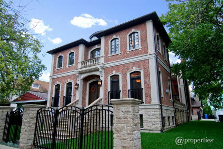 This fairly new brick and limestone home is located at 4056 N Lowell Avenue  in Chicago, IL and is the builder's own home. It is set on a corner double  lot ...
