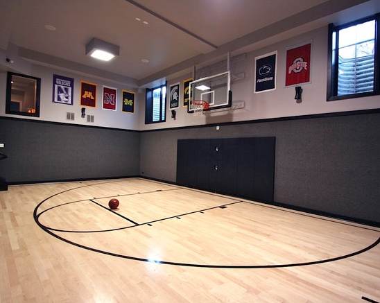 A look at some private indoor basketball courts from houzz for Indoor basketball court construction