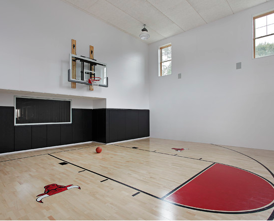 A look at some private indoor basketball courts from houzz for Home plans with indoor sports court