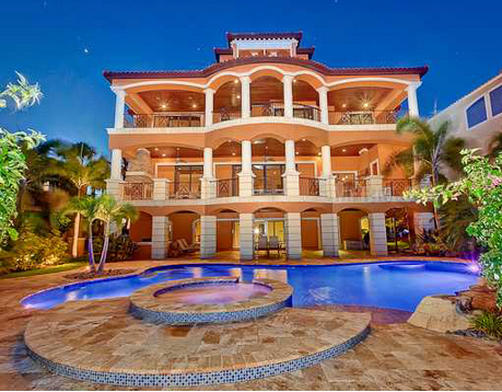 Million waterfront mediterranean mansion in port for Cheap luxury homes