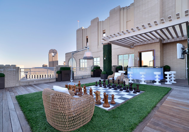A Modern Luxury Rooftop Garden Overlooking The Skyline Of