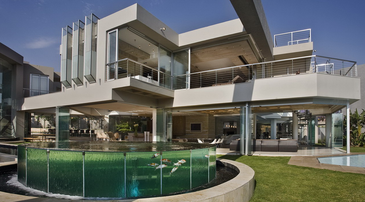 This amazing modern mansion dubbed glass house is located in johannesburg south africa it was designed by nico van der meulen architects