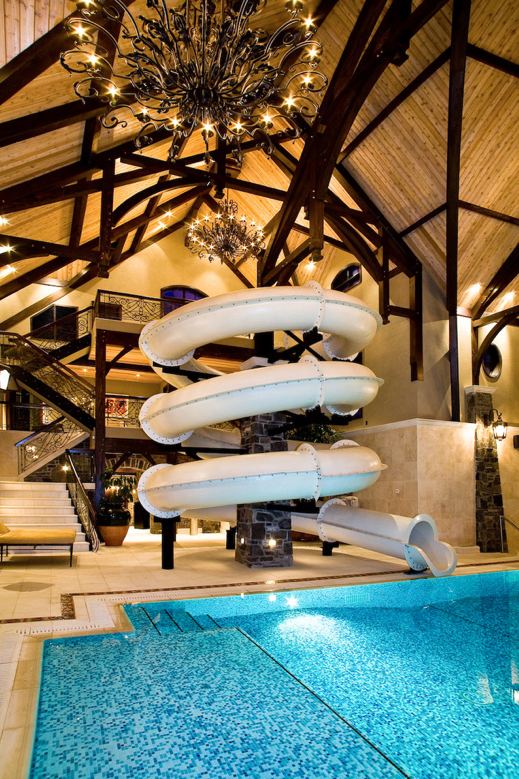 amazing 3 story indoor swimming pool with water slide rock climbing wall