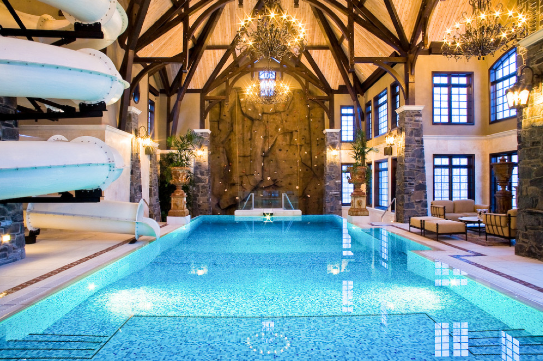 Indoor pool with waterslide  Amazing 3-Story Indoor Swimming Pool With Water Slide & Rock ...