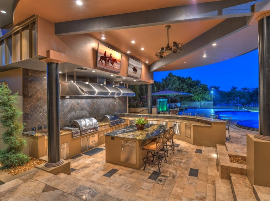 Million waterfront mansion in ormond beach fl with backyard oasis homes of the rich for Outdoor kitchen hood designs