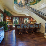2-story Foyer w/ Staircase & Wet Bar