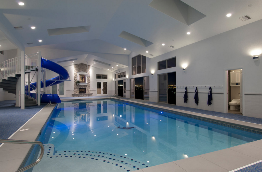 Indoor swimming pools homes of the rich for Mansion plans with indoor pool