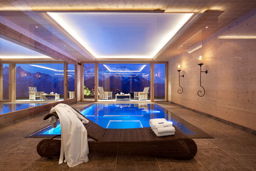 Indoor swimming pools homes of the rich for Modern house designs with indoor pool