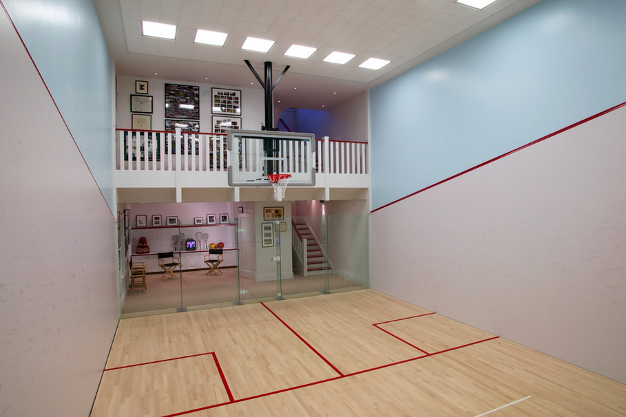 Indoor basketball courts homes of the rich for Home indoor basketball court cost