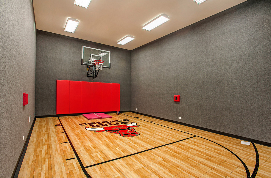 Indoor basketball courts homes of the rich for Build indoor basketball court
