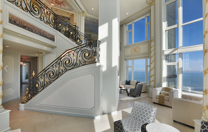 6 4 million duplex penthouse atop the four seasons hotel for Interior design for duplex living room
