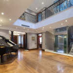 2-story Foyer w/ Staircase & Elevator
