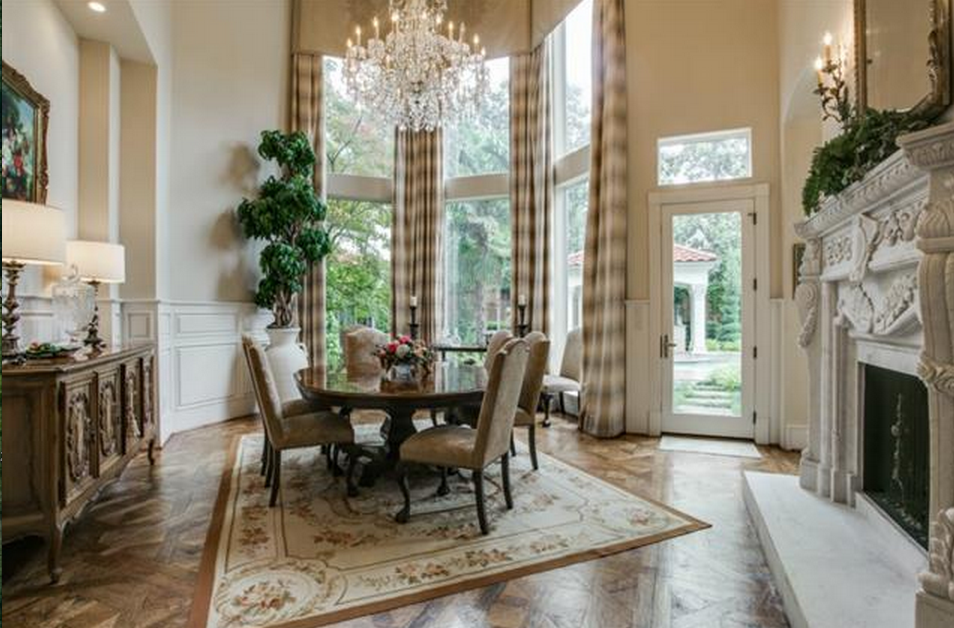 Traditional dining room with cement fireplace chandelier for Traditional dining room fireplace