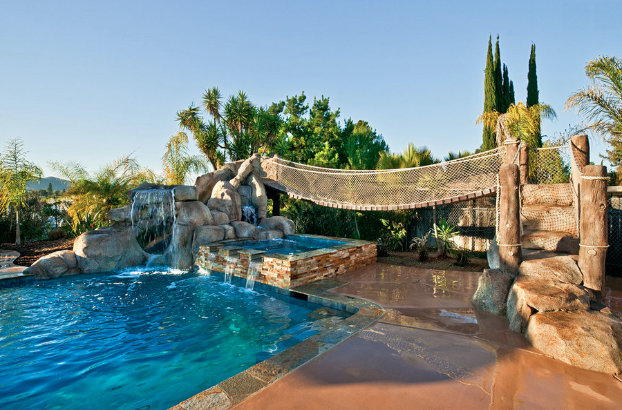 20 awesome swimming pools with water slides homes of the rich for How much water is in a swimming pool