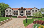 $6.495 Million Beachfront Limestone Mansion In Highland Park, IL