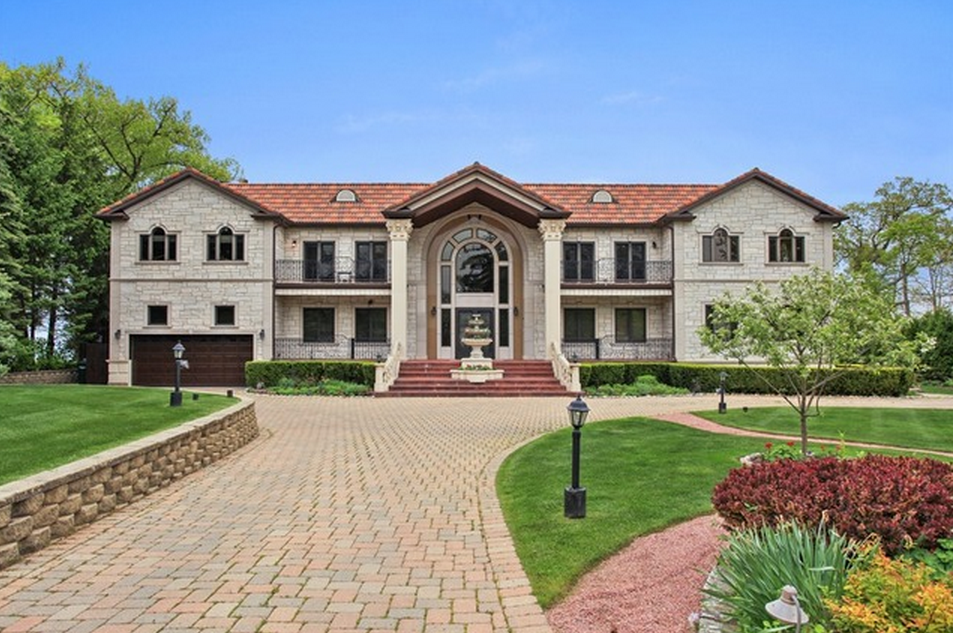 $6.495 Million Beachfront Limestone Mansion In Highland Park, IL