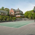 Rear Exterior w/ Tennis/Basketball Court