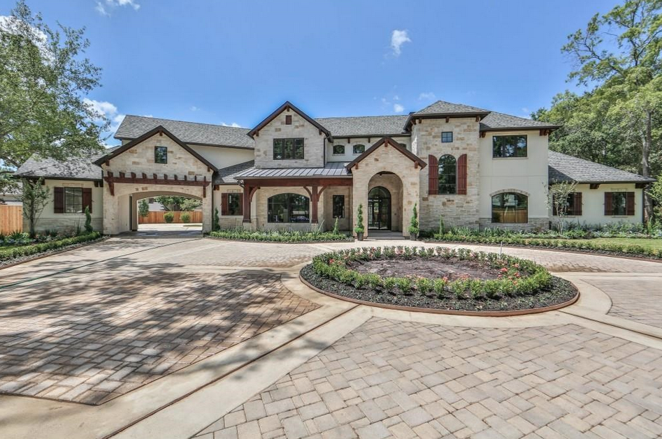 Million newly built stone stucco home in houston for Texas stone homes
