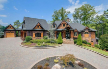 Lakefront Craftsman Style Brick Mansion In Gainesville, GA
