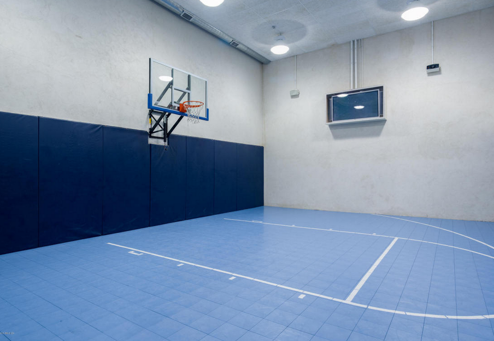 21 000 square foot european inspired mansion in greenwich for How many square feet is a basketball court
