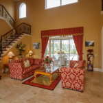2-story Living Room w/ Staircase