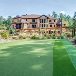 Rear Exterior w/ Putting Green