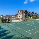Rear Exterior w/ Tennis Court