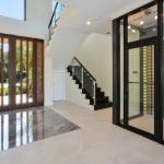 2-story Foyer w/ Staircase & Wine Cellar