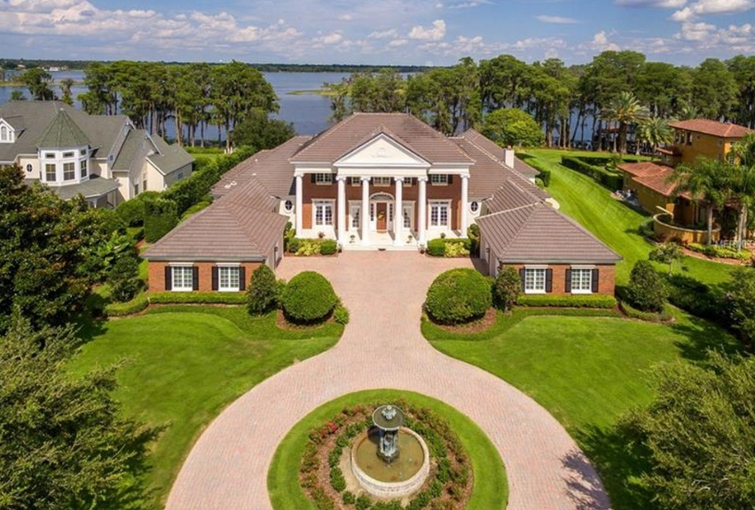$4.295 Million Lakefront Brick Mansion In Windermere, FL