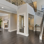 2-story Foyer w/ Staircase & Wine Cellar