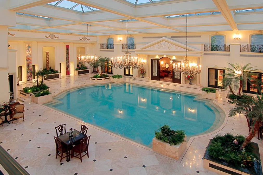 3 homes on the market with insane 2 story indoor swimming for Elaborate swimming pools