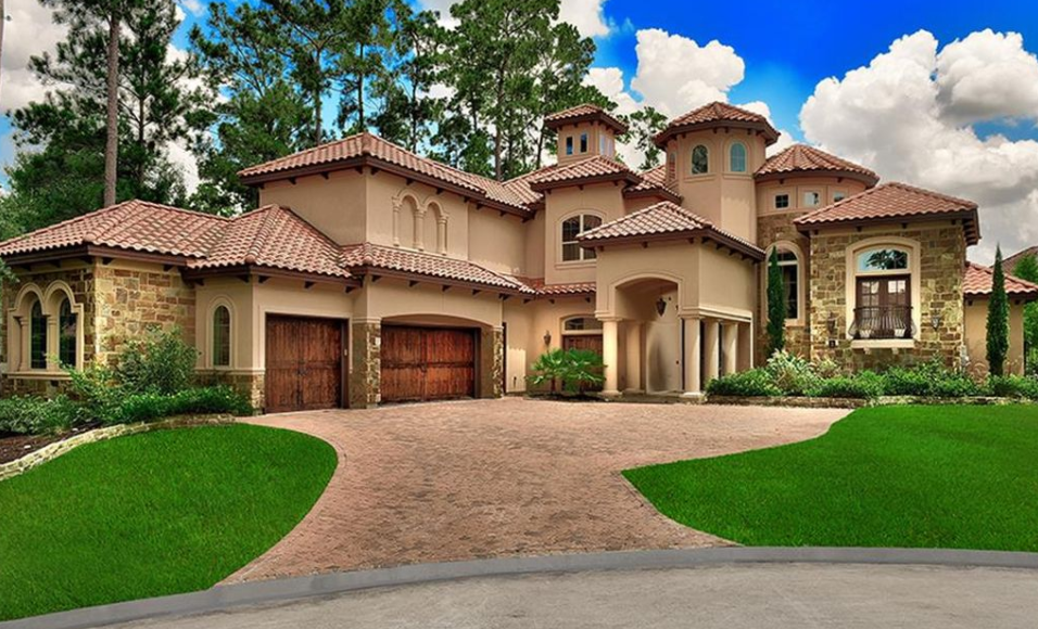 Mediterranean style home in the woodlands texas homes for Mediterranean style house exterior