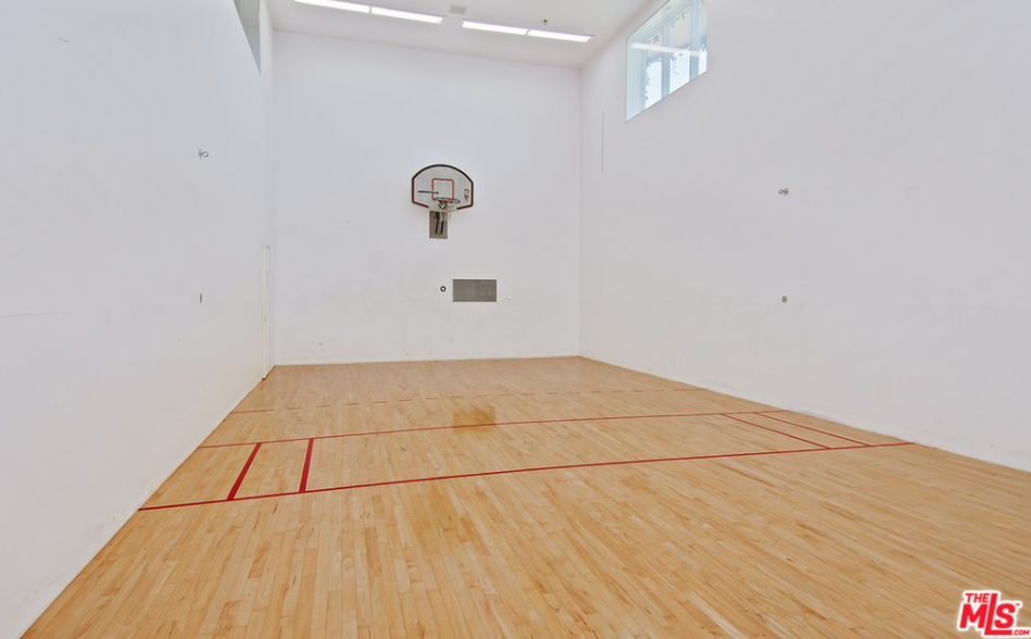 22 000 square foot mediterranean style mansion in encino for Average cost racquetball court