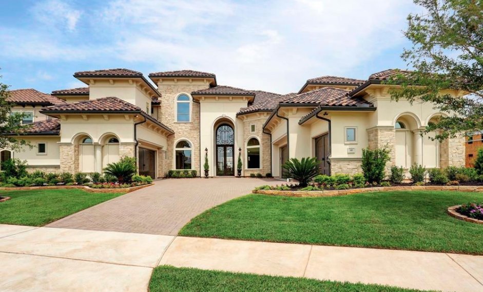Newly built stone stucco home in sugar land texas for Modern alternatives to stucco