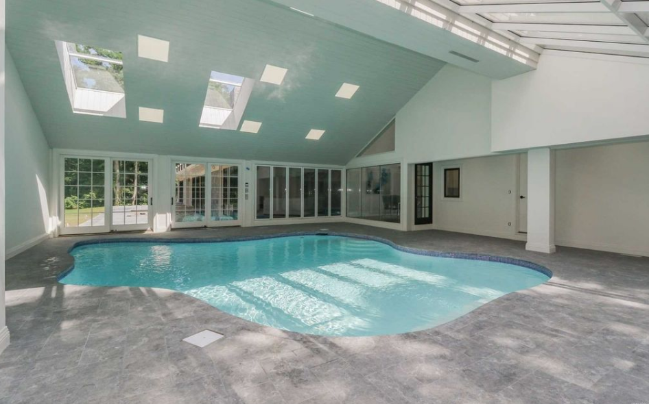 11 000 square foot home on long island with indoor pool for Average square footage of a pool